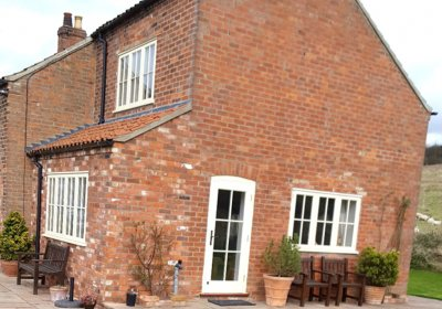 Replacement wooden windows and doors for a period cottage
